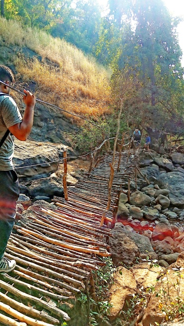 Wooden bridge made by locals to cross the flowing water during monsoons